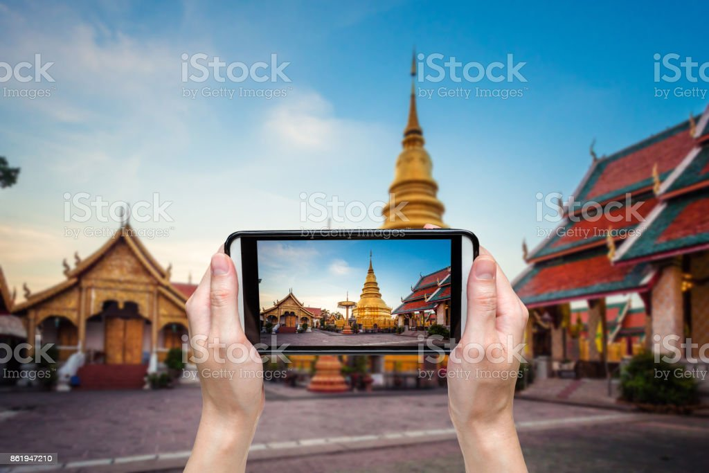 Hand taking photo at Wat phra that hariphunchai was a measure of the Lamphun,ThailandWat phra that hariphunchai was a measure of the Lamphun,Thailand stock photo