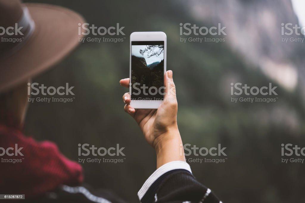 Hand taking photo of scenic mountain view stock photo
