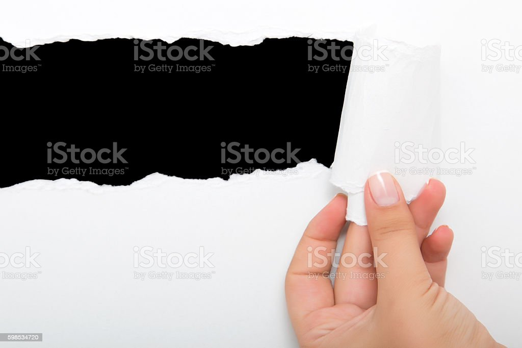 Hand tear a strip of white paper photo libre de droits