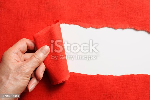 170011440 istock photo Hand tearing a red paper against white background 175419634