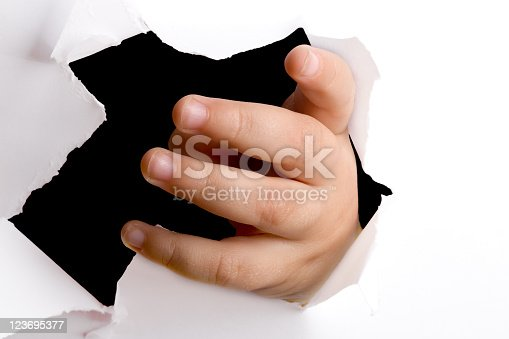 istock Hand through paper 123695377