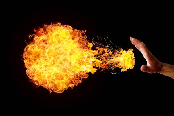 Hand throwing a fireball stock photo