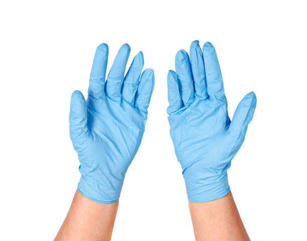 Hand throwing away blue disposable gloves stock photo