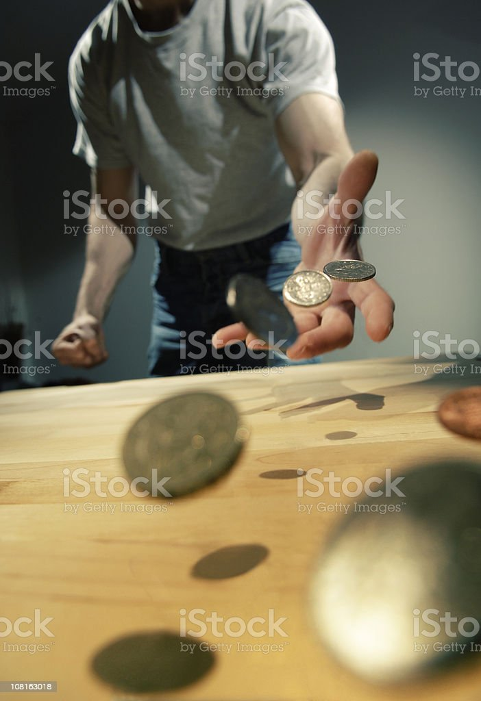 hand throwing coins royalty-free stock photo