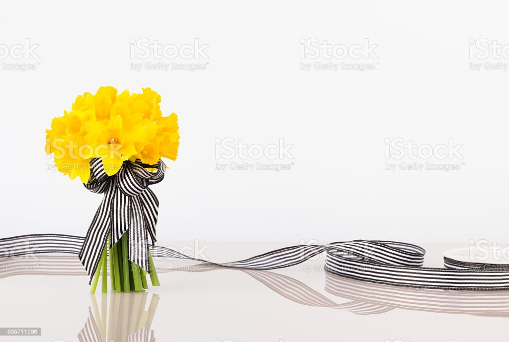 Hand tied tulip bouquet with ribbon stock photo
