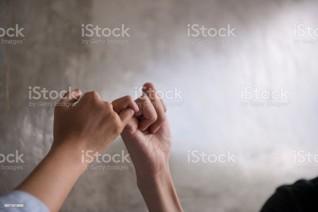 Hand to pinky swear, pinky promise hand signs. stock photo