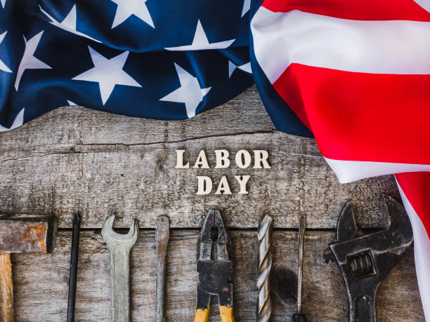 LABOR DAY. Hand tools and wooden letters stock photo