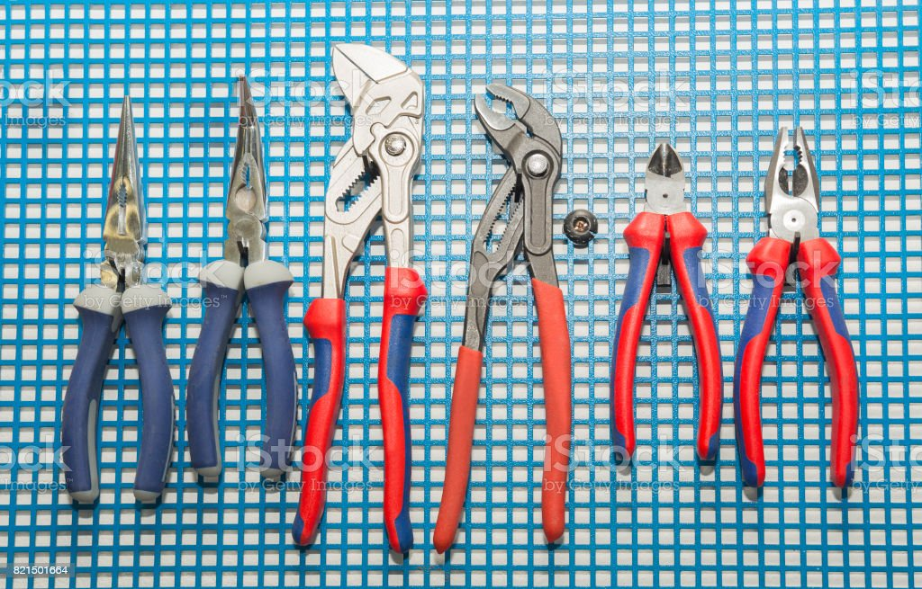 Hand Tools  Pliers, nippers  Set on mat stock photo