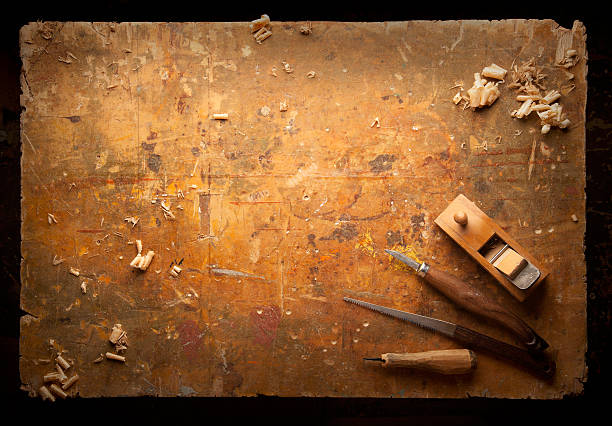 hand tools wood on an old wooden workbench - carpenter stock photos and pictures