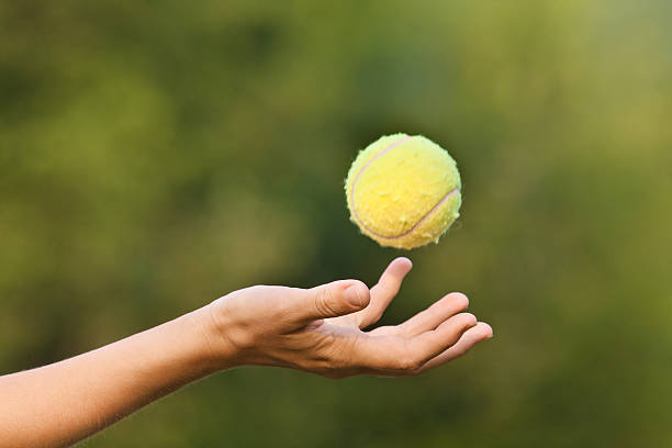 hand tossing tennis ball - Photo