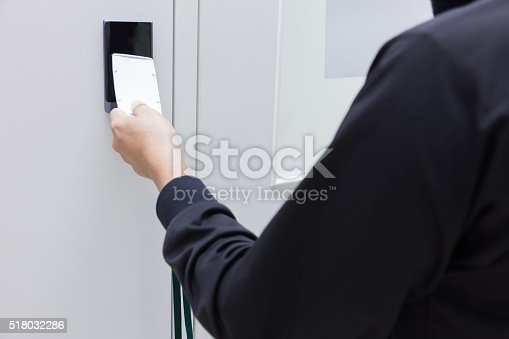 istock hand touch Security alarm keypad with card 518032286