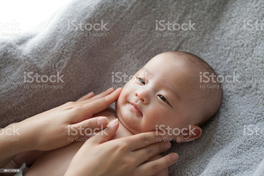 A hand touching a baby. royalty-free stock photo