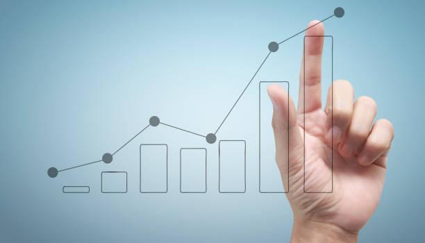 Hand berühren eines Diagramms des Finanzindikators und des Buchhaltungsmarktdiagramms – Foto
