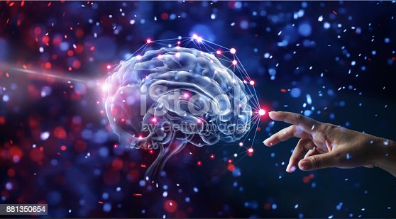 istock Hand touching brain and network connection on glitter bright lights colorful  background 881350654