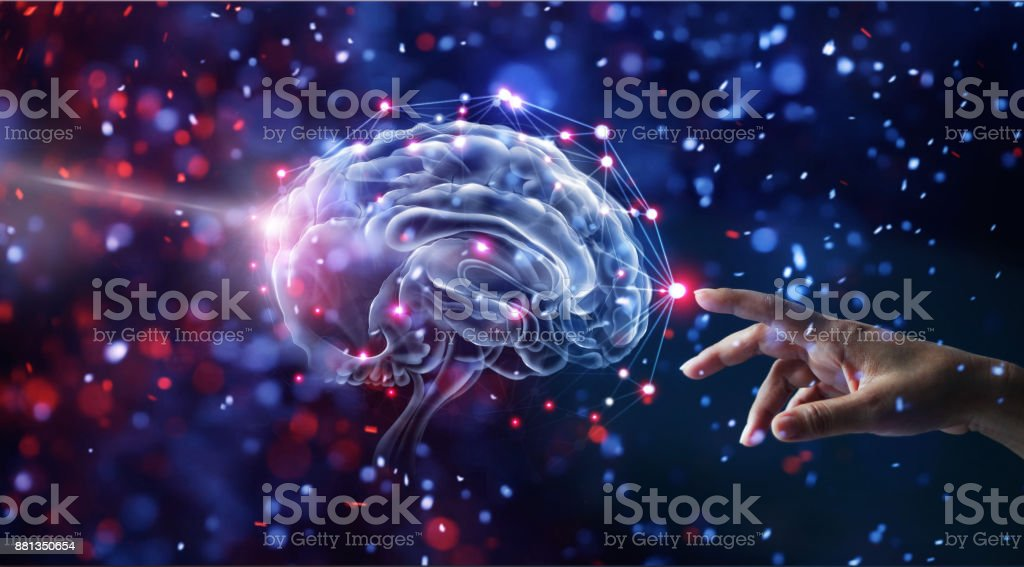 Hand touching brain and network connection on glitter bright lights colorful  background stock photo