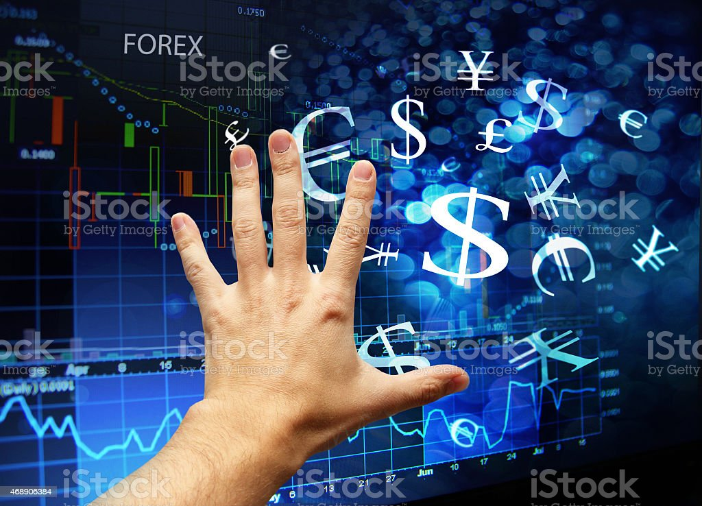hand touching forex interface stock photo