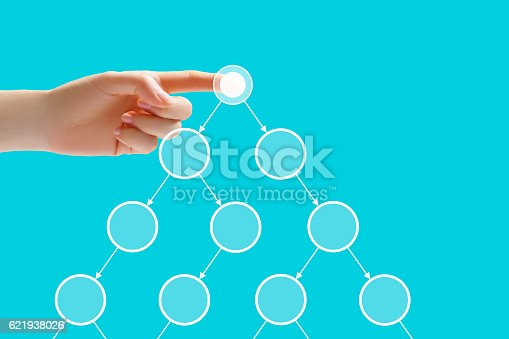 istock Hand touching interface on blue background 621938026