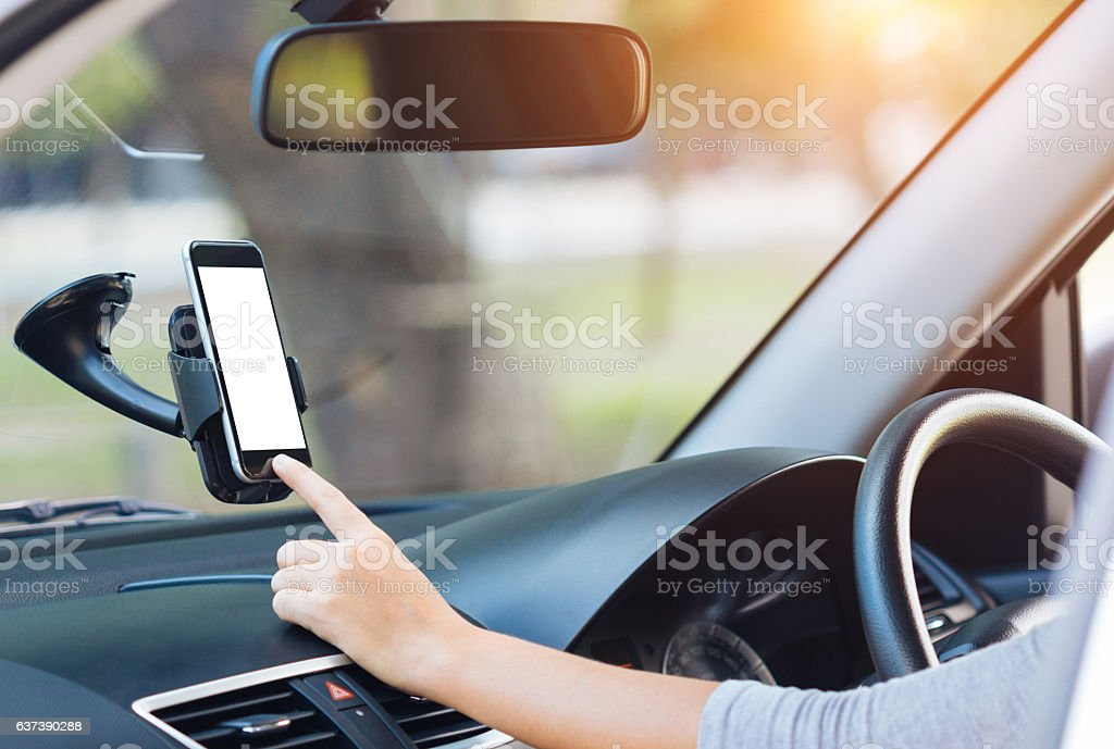 hand touching on phone mobile white screen in car stock photo