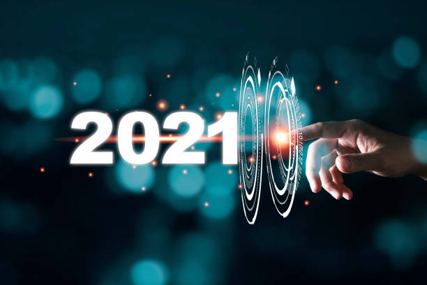Hand touching pass thru infographic to 2021 year with blue bokeh and dark background. New year change concept. Hand touching pass thru infographic to 2021 year with blue bokeh and dark background. New year change concept. 2021 stock pictures, royalty-free photos & images