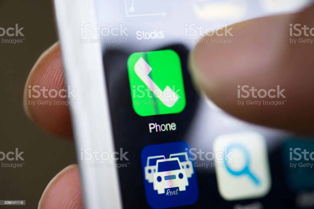 Hand touching phone app on screen royalty-free stock photo