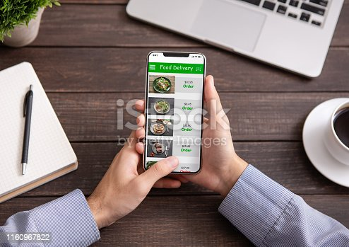 istock Hand touching phone screen for choosing food 1160967822