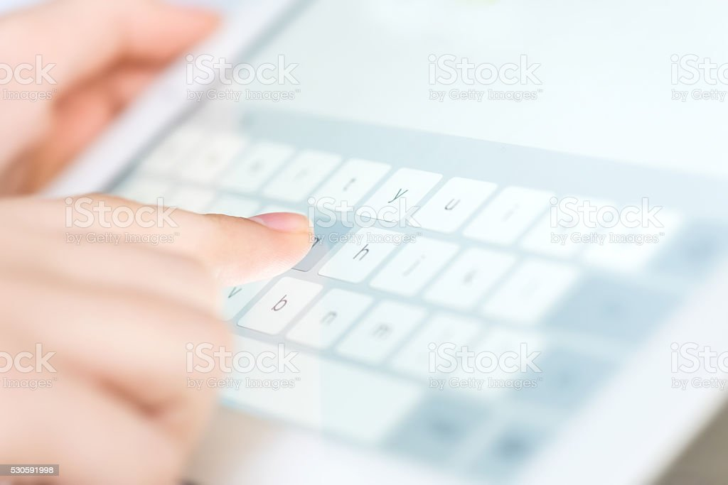 Hand touching screen on modern digital tablet pc. stock photo