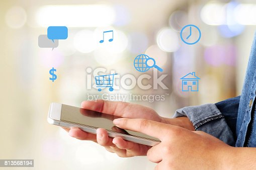 istock Hand touching smart phone screen and the internet of things icon over blur background, smart city concept, network technology, digital marketing 813568194
