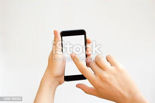 istock Hand touching smartphone blank screen. 1059789392