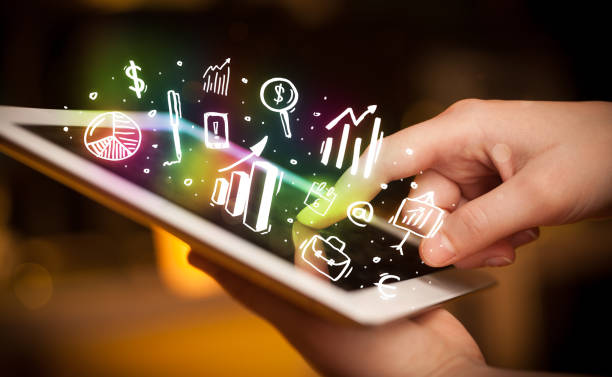 Hand touching tablet pc, charts concept stock photo