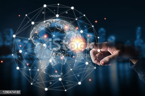 1064982786 istock photo Hand touching virtual world with connection network. Global data information and technology exchange. 1250474132