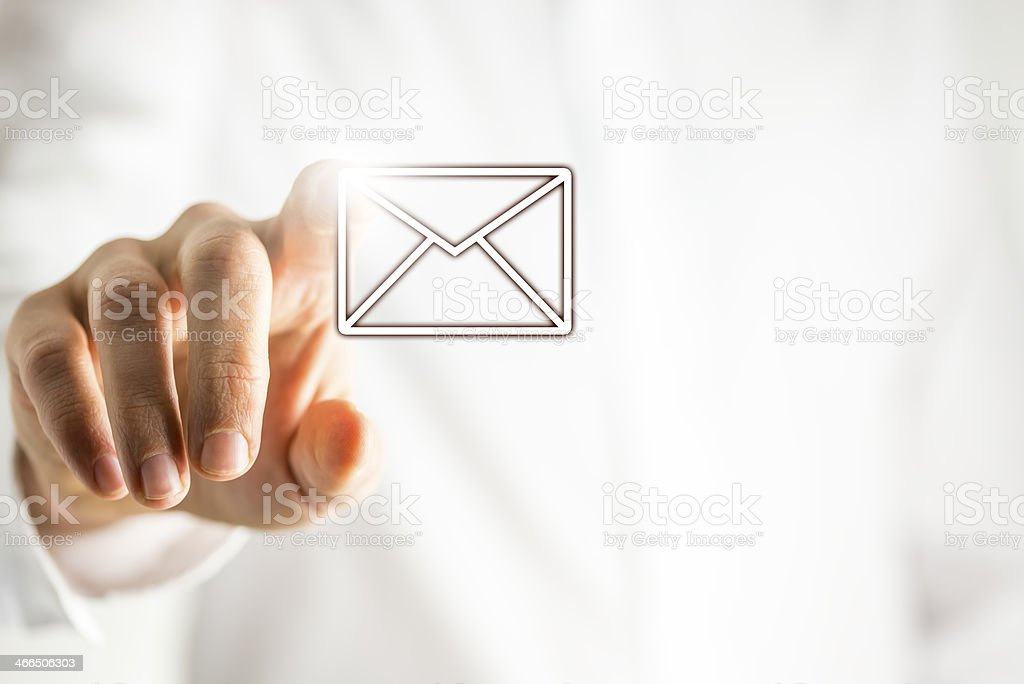 Hand tracing over a digital email icon stock photo