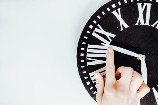 istock Hand translates an arrow on the clock. 1225663967