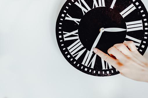 istock Hand translates an arrow on the clock. 1225664058