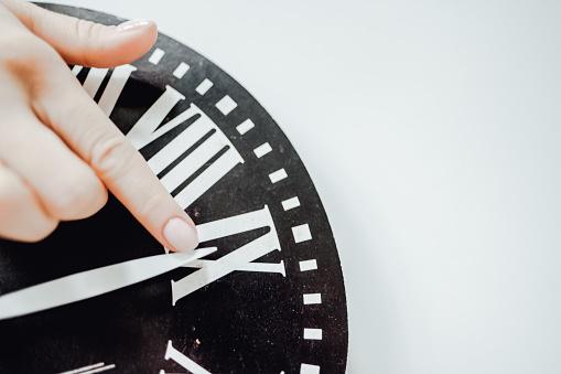 istock Hand translates an arrow on the clock. 1225664094