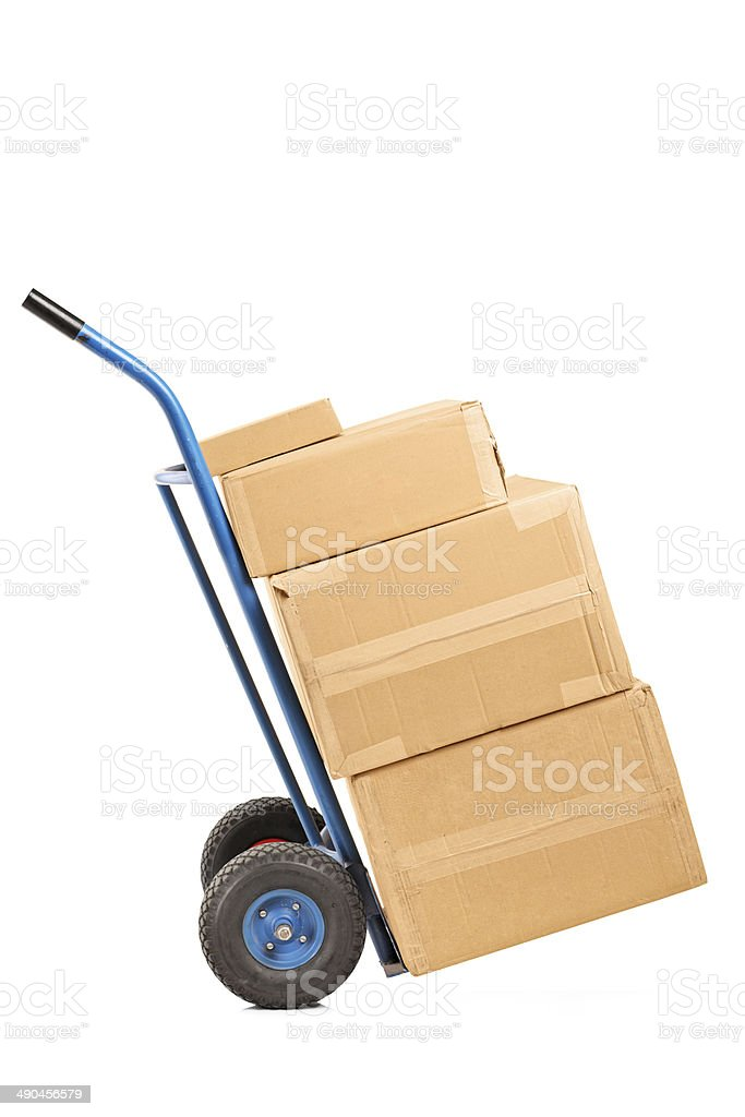 Hand truck full of boxes stock photo