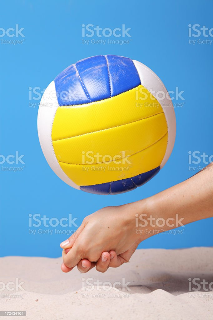 Hand trying to catch a volleyball ball at the beach royalty-free stock photo