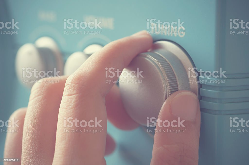 Hand tuning fm radio button. stock photo