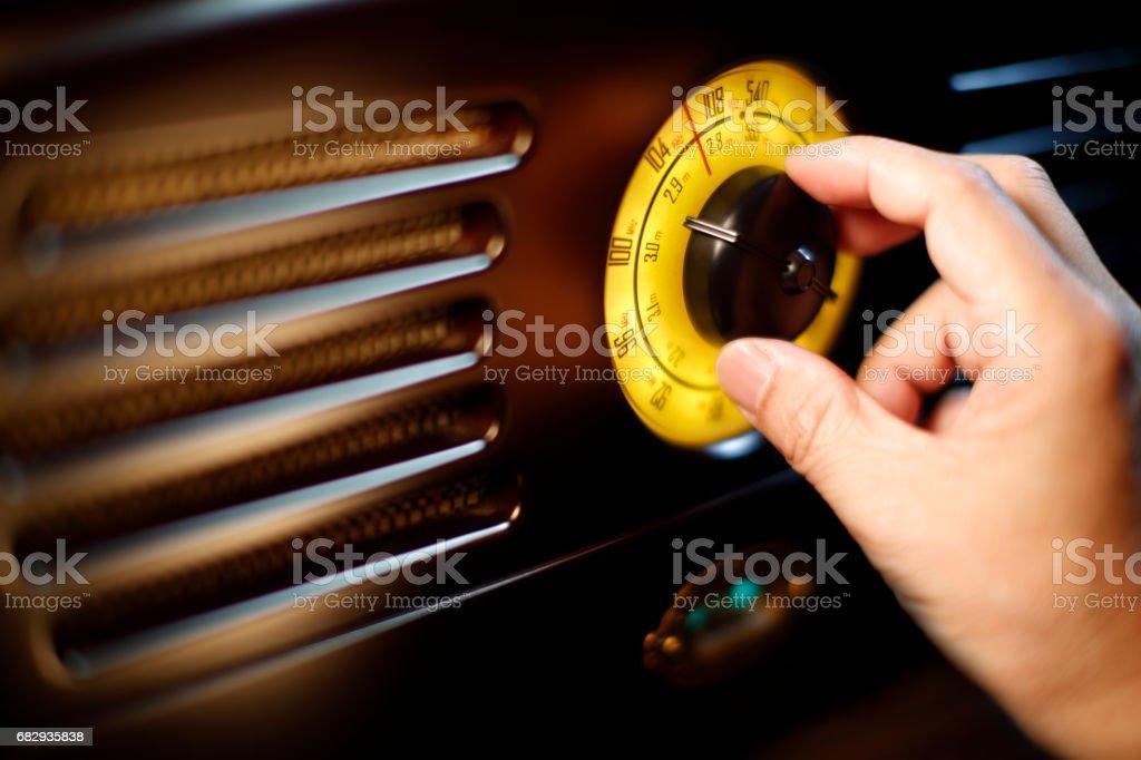 Hand tuning fm Retro radio knob stock photo