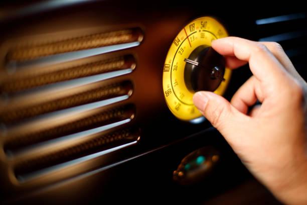 hand tuning fm retro radio knob - radio stock photos and pictures