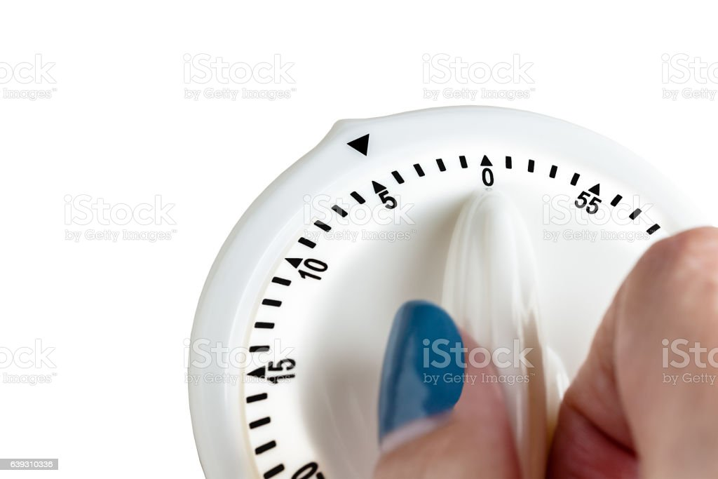 Hand tuning white button, button switch time scale stock photo