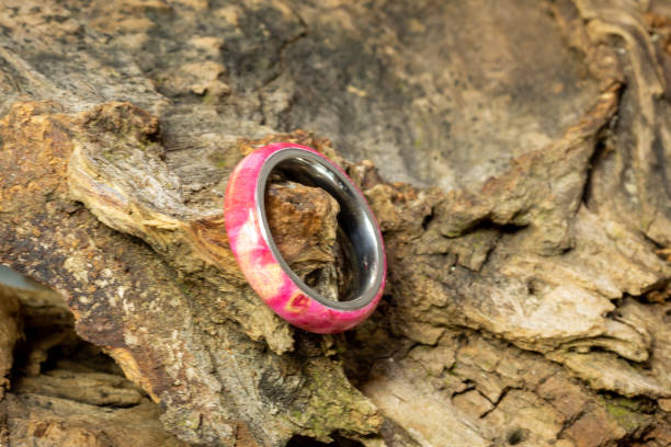 hand turned natural wood ring on stainless steel band stock photo