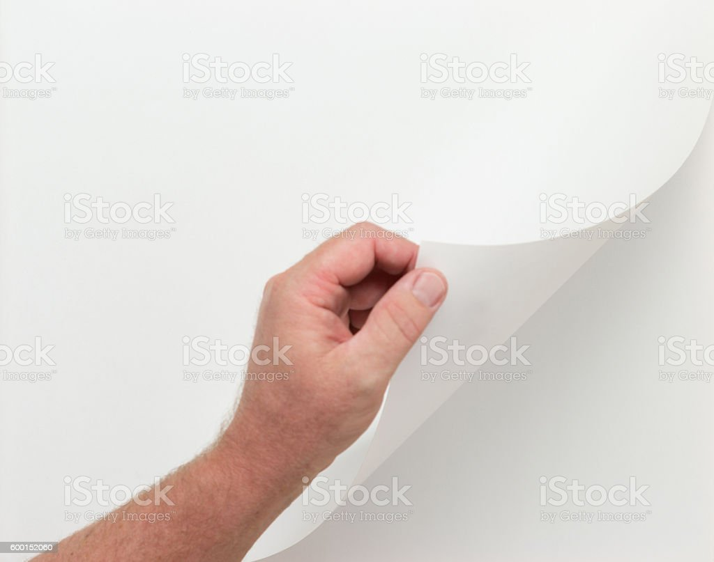 Hand Turning Blank Page with Clipping Paths stock photo