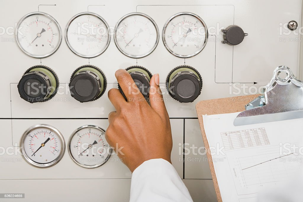 Hand Turning Dial in Medical Lab stock photo
