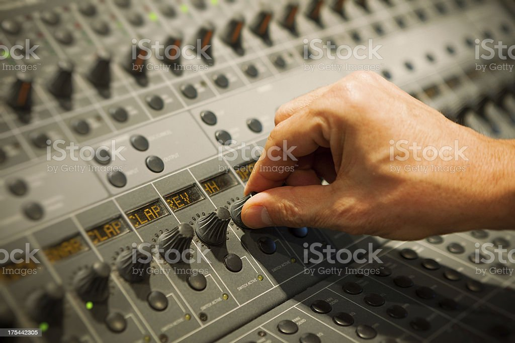 Hand turning knob in a professional mixer royalty-free stock photo