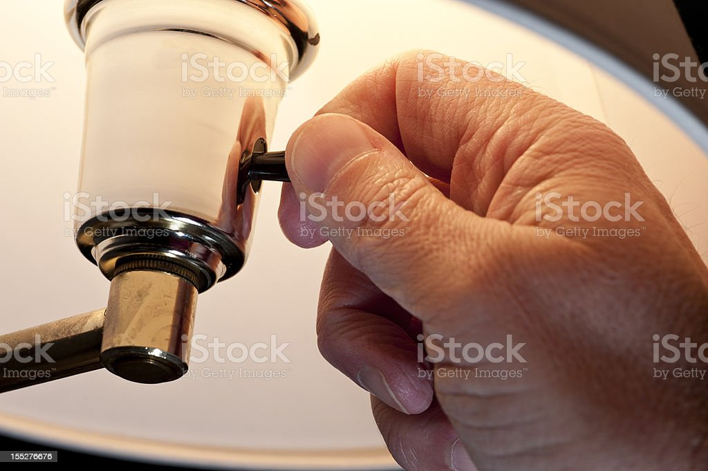 Hand Turning On Electric Lamp stock photo