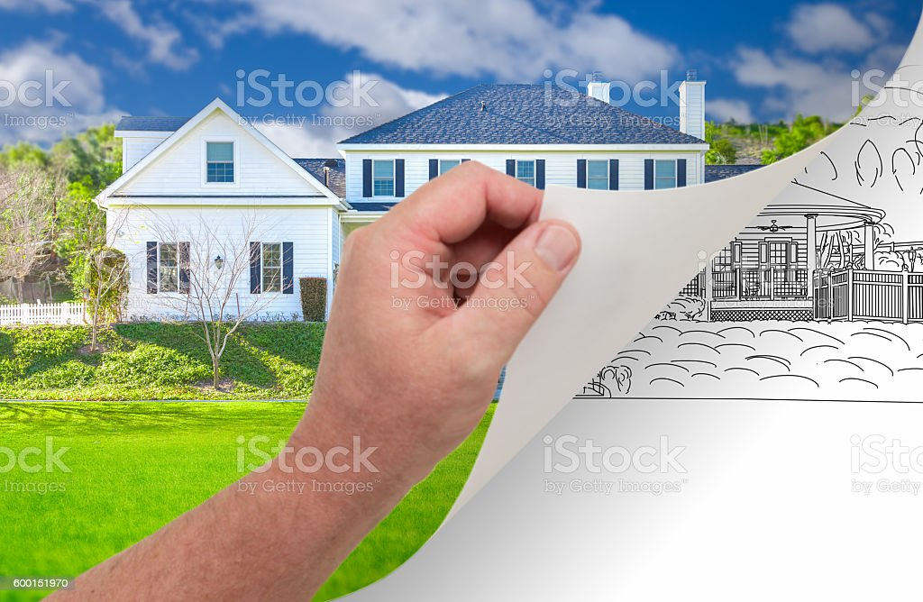 Hand Turning Page of Custom Home Photograph to Drawing stock photo