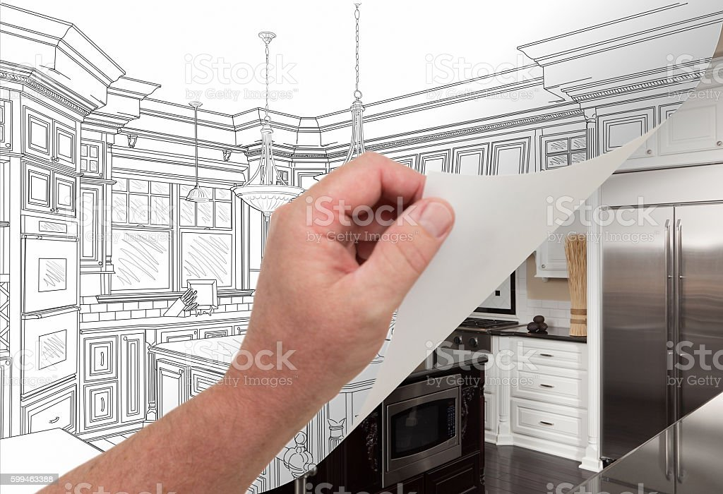 Hand Turning Page of Custom Kitchen Drawing to Photograph. stock photo