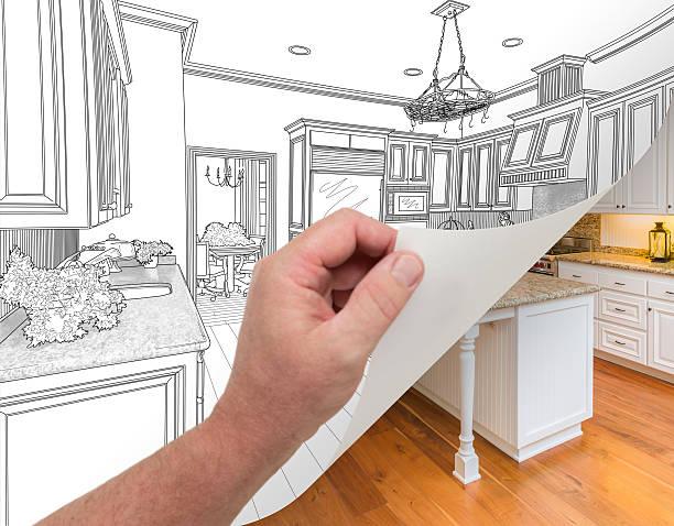 hand turning page of custom kitchen drawing to photograph. - küche neu gestalten ideen stock-fotos und bilder