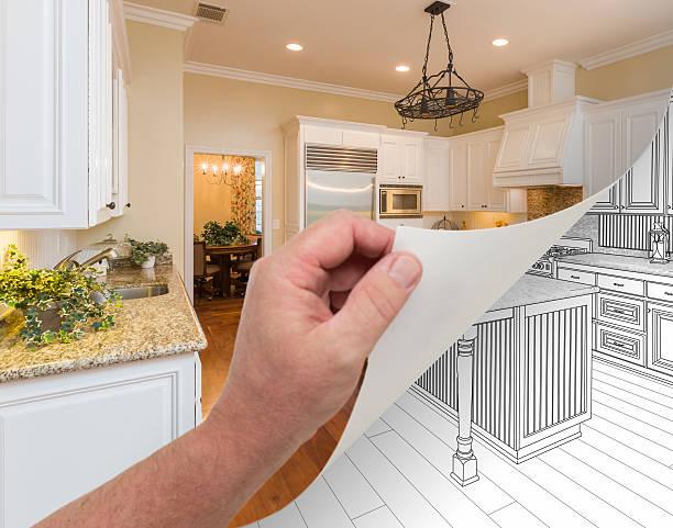 hand turning page of custom kitchen photograph to drawing - küche neu gestalten ideen stock-fotos und bilder