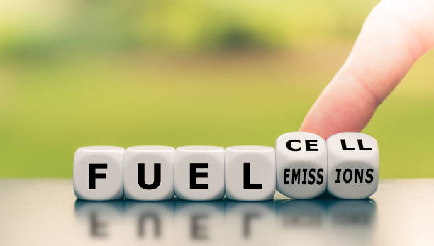"""hand turns a dice and changes the expression """"fuel emissions"""" to """"fuel cell"""". - pila a idrogeno foto e immagini stock"""
